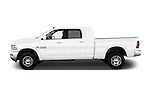 Car driver side profile view of a 2015 Ram 2500 Laramie 4 Door Truck
