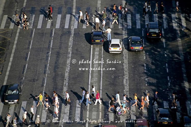 Pedestrians on a zebra crossing on the Champs-Élysées, Paris, France.
