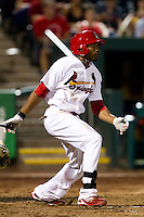 Daryl Jones (4) of the Springfield Cardinals follows through on his swing during a game against the Midland RockHounds at Hammons Field on July 11, 2011 in Springfield, Missouri. (David Welker / Four Seam Images)
