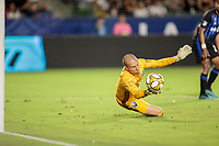 CARSON, CA - SEPTEMBER 21: Evan Bush #1 of the Montreal Impact dives to his right while defending his goal during a game between Montreal Impact and Los Angeles Galaxy at Dignity Health Sports Park on September 21, 2019 in Carson, California.