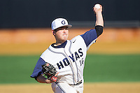 Georgetown Hoyas relief pitcher Gino Basso (16) delivers a pitch to the plate against the Marshall Thundering Herd at Wake Forest Baseball Park on February 15, 2014 in Winston-Salem, North Carolina.  The Thundering Herd defeated the Hoyas 5-1.  (Brian Westerholt/Four Seam Images)