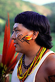 Roraima, Brazil. Davi Yanomami, spokesman for his people, with face and body paint and feather and bead decorations.