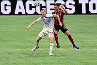 """ATLANTA, GA - AUGUST 29: Gonzalo """"Pity"""" Martinez #10 of Atlanta United competes for the ball with Oriol Rosell #20 of Orlando City during a game between Orlando City SC and Atlanta United FC at Marecedes-Benz Stadium on August 29, 2020 in Atlanta, Georgia."""