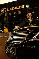 A man cleans a Lexus car in the Guangzhou Luxury Goods Fair in China..16 Dec 2006