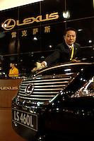 A man cleans a Lexus car in the Guangzhou Luxury Goods Fair in China..16 Dec 2006