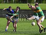 Naomh Mairtin Brian Berrill Sean O'Mahony's Johnny Connolly. Photo:Colin Bell/pressphotos.ie
