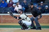 Wake Forest Demon Deacons catcher Shane Muntz (11) catches a pitch as home plate umpire Jamie Roebuck looks on during the game against the Gardner-Webb Runnin' Bulldogs at David F. Couch Ballpark on February 18, 2018 in  Winston-Salem, North Carolina. The Demon Deacons defeated the Runnin' Bulldogs 8-4 in game one of a double-header.  (Brian Westerholt/Four Seam Images)