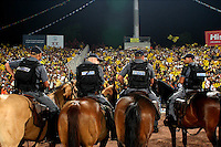 Israeli mounted police controls Betar Jerusalem fans as they celebrate the National Cup winning during the final of the Israeli cup against Macabi Haifa, 2008 - 9. Beitar won the cup in a 3 - 0 result. Beitar Jerusalem FC was founded in the 1930's by the right-wing Revisionist Zionist movement, which later formed the Israeli Likud political party, during the British Mandate rule over Palestine. The chanting of the club is racist and mainly against Arabs. The team is the only one in the Israeli league to have never had an Arab player. Beitar is seen as the right wing and Mizrahi (Jews who came from Asia and Africa) club. Photo by Quique Kierszenbaum