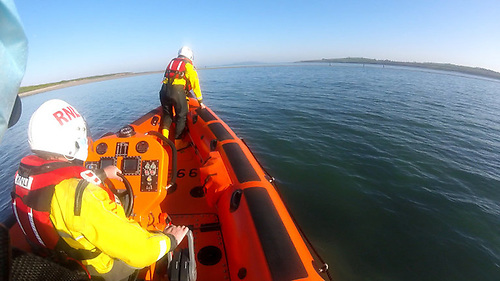 Skerries RNLI's inshore lifeboat approaches a group of children stranded on Shenick Island by the incoming tide
