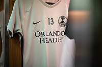 ORLANDO, FL - SEPTEMBER 11: Alex Morgan #13 of the Orlando Pride's kit in the locker room before a game between Racing Louisville FC and Orlando Pride at Exploria Stadium on September 11, 2021 in Orlando, Florida.