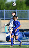 NWA Democrat-Gazette/CHARLIE KAIJO Bentonville High School Logan Turner (2) heads the ball during a soccer game, Friday, April 26, 2019 at  Whitey Smith Stadium at Rogers High School in Rogers.