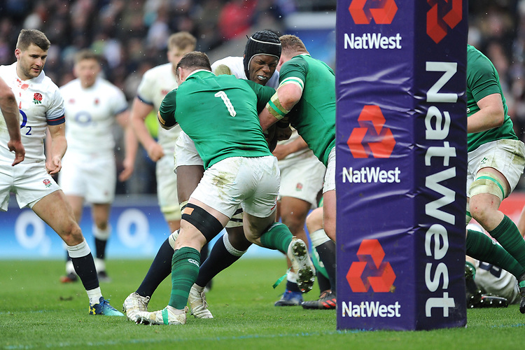Maro Itoje of England is stopped short of the line by Cian Healy of Ireland during the NatWest 6 Nations match between England and Ireland at Twickenham Stadium on Saturday 17th March 2018 (Photo by Rob Munro/Stewart Communications)
