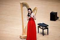 Se Hee Hwang from South Korea speaks before performing during Stage III at the 11th USA International Harp Competition at Indiana University in Bloomington, Indiana on Wednesday, July 10, 2019. (Photo by James Brosher)