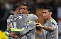 Calcio, andata degli ottavi di finale di Champions League: Roma vs Real Madrid. Roma, stadio Olimpico, 17 febbraio 2016.<br /> Real Madrid's Cristiano Ronaldo, center, celebrates with teammates Sergio Ramos, left, and James Rodriguez, after scoring during the first leg round of 16 Champions League football match between Roma and Real Madrid, at Rome's Olympic stadium, 17 February 2016.<br /> UPDATE IMAGES PRESS/Riccardo De Luca