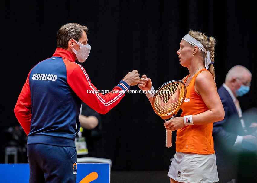Den Bosch, The Netherlands, April 16, 2021,    Maaspoort, Billy Jean King Cup  Netherlands -  China , First Match: Kiki Bertens (NED)  is congratulated by captain Paul Haarhuis (NED)<br /> Photo: Tennisimages/Henk Koster
