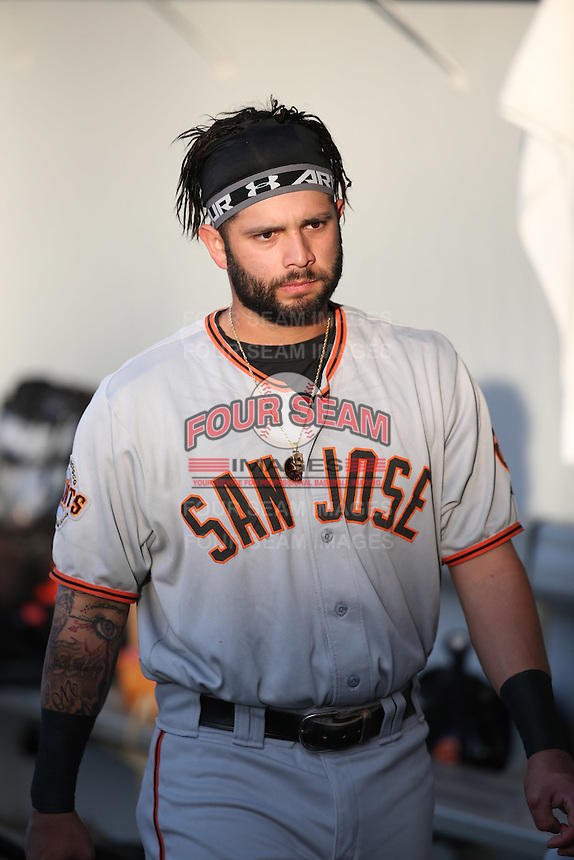 C.J. Hinojosa (2) of the San Jose Giants in the dugout before a game against the Rancho Cucamonga Quakes at LoanMart Field on May 23, 2016 in Rancho Cucamonga, California. San Jose defeated Rancho Cucamonga, 4-2. (Larry Goren/Four Seam Images)