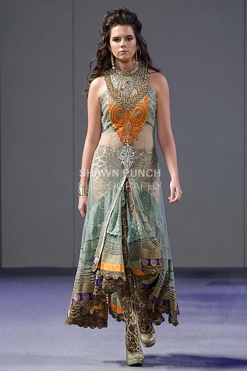 Model walks runway in an outfit from the Charisma collection by Ritu Boorgu, during Couture Fashion Week Spring 2013 in NYC, on September 16, 2013.