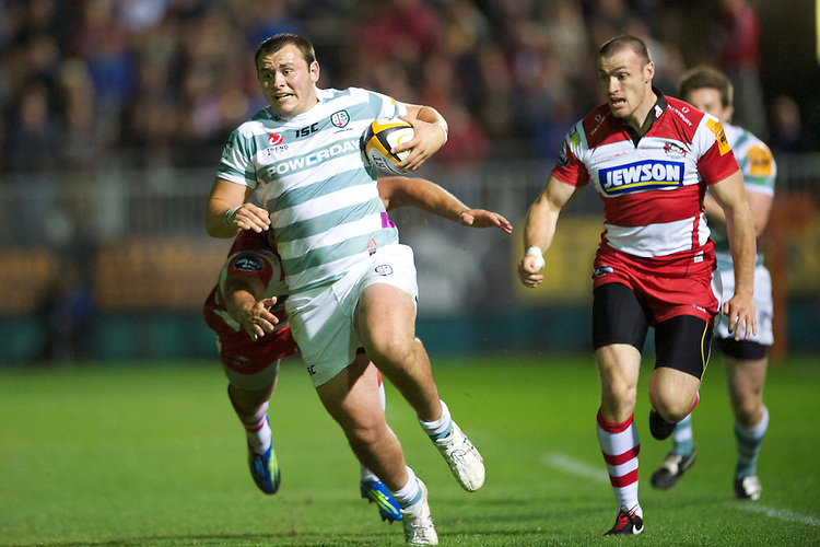 20120803 Copyright onEdition 2012©.Free for editorial use image, please credit: onEdition..Gerard Ellis of London Irish in action against Gloucester Rugby 7s at The Recreation Ground, Bath in the Final round of The J.P. Morgan Asset Management Premiership Rugby 7s Series...The J.P. Morgan Asset Management Premiership Rugby 7s Series kicked off again for the third season on Friday 13th July at The Stoop, Twickenham with Pool B being played at Edgeley Park, Stockport on Friday, 20th July, Pool C at Kingsholm Gloucester on Thursday, 26th July and the Final being played at The Recreation Ground, Bath on Friday 3rd August. The innovative tournament, which involves all 12 Premiership Rugby clubs, offers a fantastic platform for some of the country's finest young athletes to be exposed to the excitement, pressures and skills required to compete at an elite level...The 12 Premiership Rugby clubs are divided into three groups for the tournament, with the winner and runner up of each regional event going through to the Final. There are six games each evening, with each match consisting of two 7 minute halves with a 2 minute break at half time...For additional images please go to: http://www.w-w-i.com/jp_morgan_premiership_sevens/..For press contacts contact: Beth Begg at brandRapport on D: +44 (0)20 7932 5813 M: +44 (0)7900 88231 E: BBegg@brand-rapport.com..If you require a higher resolution image or you have any other onEdition photographic enquiries, please contact onEdition on 0845 900 2 900 or email info@onEdition.com.This image is copyright the onEdition 2012©..This image has been supplied by onEdition and must be credited onEdition. The author is asserting his full Moral rights in relation to the publication of this image. Rights for onward transmission of any image or file is not granted or implied. Changing or deleting Copyright information is illegal as specified in the Copyright, Design and Patents Act 1988. If you are in any way unsure of your right to publish this