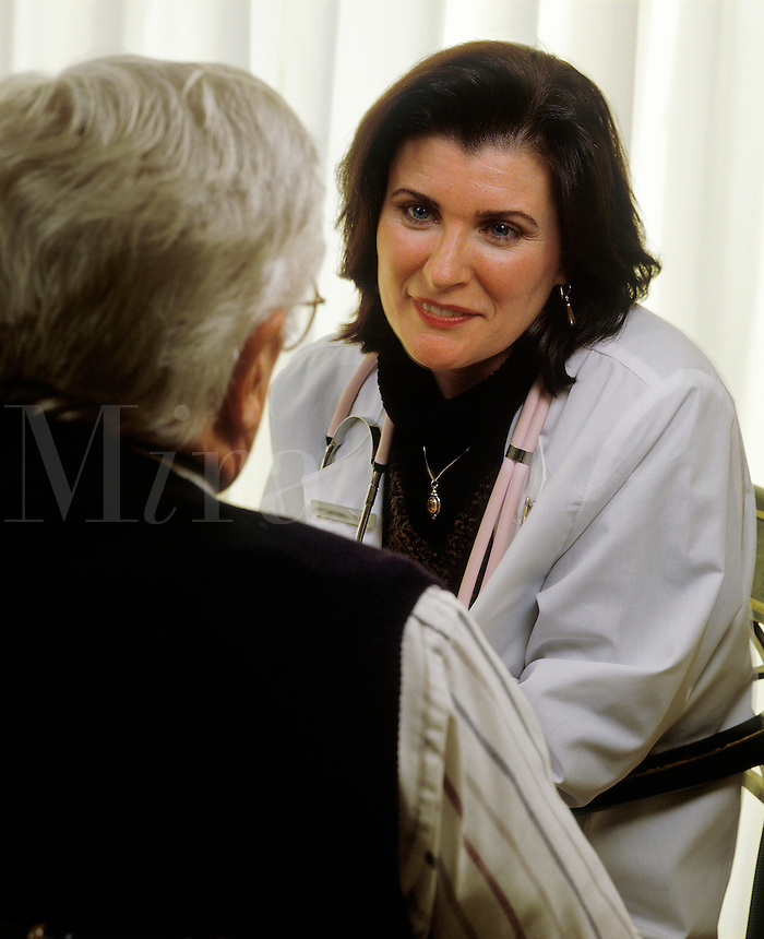 Female nurse or doctor with elderly patient.