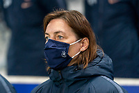 LE HAVRE, FRANCE - APRIL 13: Corinne Diacre of France watches her team before a game between France and USWNT at Stade Oceane on April 13, 2021 in Le Havre, France.