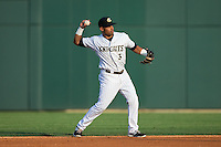 Micah Johnson (3) of the Charlotte Knights makes a throw to first base against the Norfolk Tides at BB&T BallPark on July 17, 2015 in Charlotte, North Carolina.  The Knights defeated the Tides 5-4.  (Brian Westerholt/Four Seam Images)