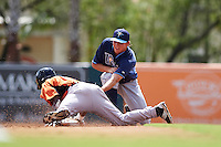 Tampa Bay Rays Michael Russell (22) attempts to tag Cedric Mullins (19) diving back to second during an instructional league game against the Baltimore Orioles on September 25, 2015 at Ed Smith Stadium in Sarasota, Florida.  (Mike Janes/Four Seam Images)