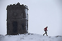 21/02/15  <br /> <br /> After heavy snow showers across the Derbyshire Peak District, a lone runner braves the cold at Solomon's Temple, also known as Grinlow Tower, near Buxton.<br /> <br /> All Rights Reserved - F Stop Press.  www.fstoppress.com. Tel: +44 (0)1335 418629 +44(0)7765 242650