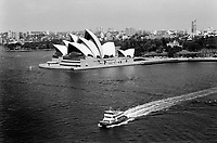 Australia. New South Wales. Sydney. The Sydney Opera House is situated on Bennelong Point in Sydney Harbour. The opera with its spherical-sectioned shells was built by the architect Jorn Utzon. The roofs of the House are constructed of 1,056,000 glazed white granite tiles. Boat ride on Pacific Ocean. 5.3.99 © 1999 Didier Ruef