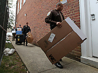 CHARLOTTESVILLE, VA - FEBRUARY 14: Police bring evidence to the Charlottesville Circuit courthouse for the George Huguely trial. Huguely was charged in the May 2010 death of his girlfriend Yeardley Love. She was a member of the Virginia women's lacrosse team. Huguely pleaded not guilty to first-degree murder. (Credit Image: © Andrew Shurtleff