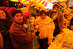 A Native nahuatl family buys cempaxochitl flowers (flowers of the deads) in the tianguis in Acaxochitlan, in northern state of Hidalgo, during the festivities of the Day of the Deads. Hundreds of Native villages pay homage to their deads on the eve of November 2 as a tradition since the preHispanic times. Photo by Heriberto Rodriguez