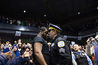 A policeman and an anti-Donald Trump activist confront each other in the Chicago Pavilion, at the University of Illinois, where the Republican presidential candidate was due to hold a campaign rally. The event was cancelled, the organisers citing safety concerns as hundreds of the anti-Trump protestors had obtained tickets for the event.