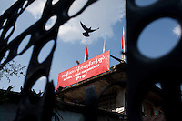 A pigeon flies over the National League of Democracy party headquarters the day after Aung San Suu Kyi was released from house arrest in Rangoon. From 1990 until her release on 13 November 2010, Aung San Suu Kyi had spent almost 15 of the 21 years under house arrest.