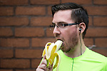 © Joel Goodman - 07973 332324 . 28/05/2017 . Manchester , UK . A runner eats a banana . The Great Manchester Run 2017 . Security is still heightened in Manchester following a murderous bomb attack at an Ariana Grande gig at Manchester Arena on Monday 22nd May . Photo credit : Joel Goodman