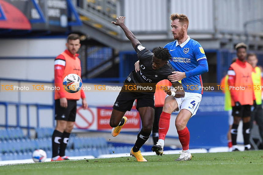 Tom Naylor of Portsmouth right tackles Madger Gomes of Doncaster Rovers during Portsmouth vs Doncaster Rovers, Sky Bet EFL League 1 Football at Fratton Park on 17th October 2020
