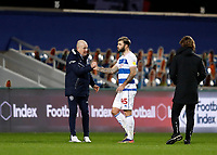 17th February 2021; The Kiyan Prince Foundation Stadium, London, England; English Football League Championship Football, Queen Park Rangers versus Brentford; Queens Park Rangers Manager Mark Warburton shakes hands with Charlie Austin of Queens Park Rangers after full timer with Brentford Manager Thomas Frank looking on