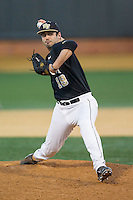 Wake Forest Demon Deacons relief pitcher Aaron Fossas (18) delivers a pitch to the plate against the Missouri Tigers at Wake Forest Baseball Park on February 22, 2014 in Winston-Salem, North Carolina.  The Demon Deacons defeated the Tigers 1-0.  (Brian Westerholt/Four Seam Images)