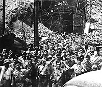 Captured Japanese photograph.  U.S. soldiers and sailors surrendering to Jap forces at Corregidor, P.I.  May 1942.  (Army)<br /> Exact Date Shot Unknown<br /> NARA FILE #:  111-SC-334296<br /> WAR & CONFLICT BOOK #:  1143
