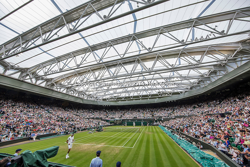 London, England, 01 July, 2016, Tennis, Wimbledon, Overall view of Centre Court with closed roof during the match between Juan Martin Del Potro (ARG) foreground and Stanislas Wawrinka (SUI)<br /> Photo: Henk Koster/tennisimages.com