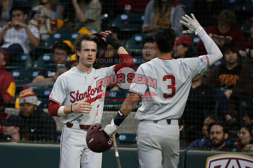Jack Klein (2) of the Stanford Cardinal is greeted by teammate Daniel Bakst (3) after scoring during a game against the Southern California Trojans at Dedeaux Field on April 6, 2017 in Los Angeles, California. Southern California defeated Stanford, 7-5. (Larry Goren/Four Seam Images)