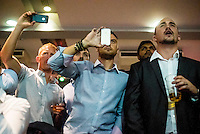Spectators take pictures on their mobile phones at a white collar boxing event at the London Irish Centre where the 'Carpe Diem' boxing event is taking place. <br /> <br /> 'White-collar boxing' is a growing phenomenon amongst well paid office workers and professionals and has seen particular growth in financial centres like London, Hong Kong and Shanghai. It started at a blue-collar gym in Brooklyn in 1988 with a bout between an attorney and an academic and has since spread all over the world. The sport is not regulated by any professional body in the United Kingdom and is therefore potentially dangerous, as was proven by the death of a 32-year-old white-collar boxer at an event in Nottingham in June 2014. The London Irish Centre, amongst other venues, hosts a regular bout called 'Carpe Diem'. At most bouts participants fight to win. Once boxers have completed a few bouts they can participate in 'title fights' where they compete for a replica 'belt'.