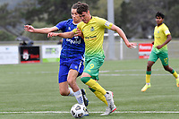 Riley Bidois of Lower Hutt AFC competes for the ball with Oliver Whitehead of Petone FC during the Central League Football - Petone FC v Lower Hutt AFC at Petone Memorial Park, Lower Hutt, New Zealand on Friday 2 April 2021.<br /> Copyright photo: Masanori Udagawa /  www.photosport.nz