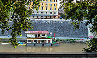 Fine Art Landscape Print Photograph. The foliage of the trees, and the textures of the walls helped to   frame this interesting scene of a houseboat that is on the Tiber river.<br />