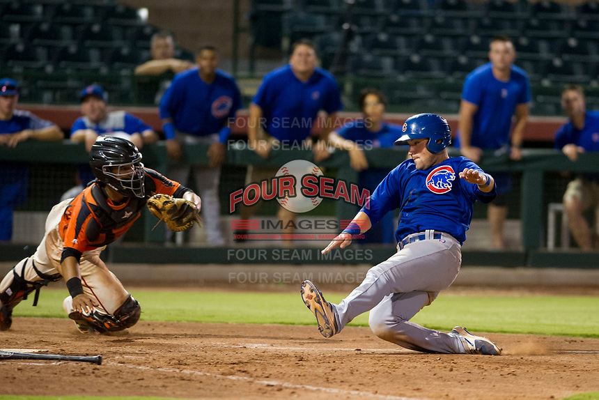 AZL Cubs third baseman Cam Balego (82) prepares to slide into home plate ahead of the tag of Ricardo Genoves (15) in a game against the AZL Giants on September 5, 2017 at Scottsdale Stadium in Scottsdale, Arizona. AZL Cubs defeated the AZL Giants 10-4 to take a 1-0 lead in the Arizona League Championship Series. (Zachary Lucy/Four Seam Images)