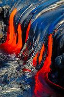 Lava flows into an old skylight, Waikupanaha ocean entry lava flow area, East of Hawaii, USA Volcanoes National Park, Kalapana, Hawaii, USA, The Big Island of Hawaii, USA