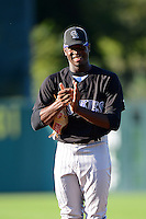 Touki Toussaint (19) of Coral Springs Christian Academy in Coral Springs, Florida playing for the Colorado Rockies scout team during the East Coast Pro Showcase on August 1, 2013 at NBT Bank Stadium in Syracuse, New York.  (Mike Janes/Four Seam Images)