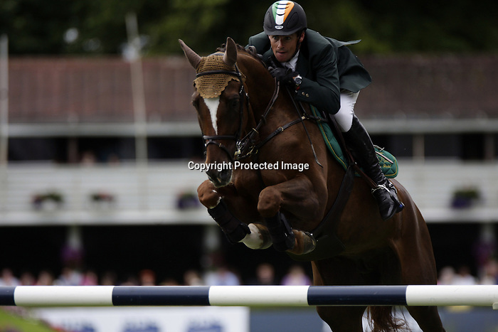 August 09, 2009: Niall Talbot (IRL) aboard Tequi D'I Ch competing in the Grand Prix event. Longines International Grand Prix. Failte Ireland Horse Show. The RDS, Dublin, Ireland.