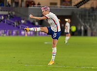 ORLANDO, FL - JANUARY 18: Megan Rapinoe #15 of the USWNT takes a shot during a game between Colombia and USWNT at Exploria Stadium on January 18, 2021 in Orlando, Florida.