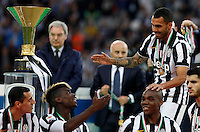 Calcio, Serie A: Juventus vs Napoli. Torino, Juventus Stadium, 23 maggio 2015. <br /> Juventus' Carlos Tevez, right, greets teammates during celebrations for the victory of the Scudetto at the end of the Italian Serie A football match between Juventus and Napoli at Turin's Juventus Stadium, 23 May 2015.<br /> UPDATE IMAGES PRESS/Isabella Bonotto