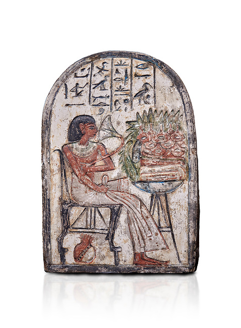 """Ancient Egyptian Ra stele , limestone, New Kingdom, 19th Dynasty, (1279-1190 BC), Deir el-Medina,  Egyptian Museum, Turin. white background, <br /> <br /> On this round-topped stele, the deceased Pashed, <br /> """"excellent spirit of Ra"""", akh-ikr, is pictured left, <br /> seated on a chair with lion's paws, smelling the lotus <br /> flower. The offering table holds a basket containing <br /> various offerings. A large open pomegranate, containing <br /> a great quantity of seeds, appears under the chair. The <br /> colours on this stele are well preserved.<br /> <br /> Akh iqer en Ra """" the excellent spirit of Ra' stele. The individual is smelling a lotus flower. One of three stele forund in different rooms of houses in Deir el-Medina where they stood in niches."""