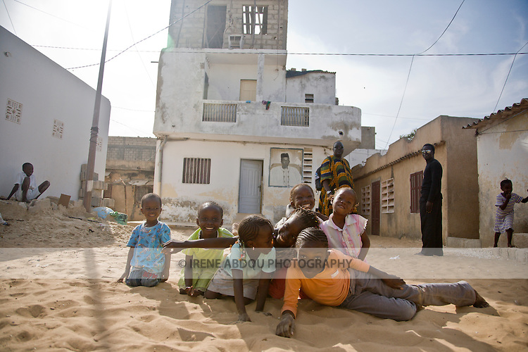 Child laugh, smile, and play in the fishing village of Yoff, 30 minutes from Senegal's capital city of Dakar.